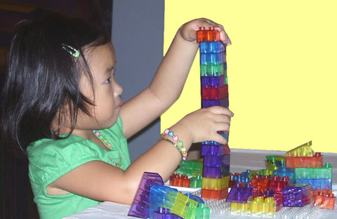 Girl-plays-with-legos