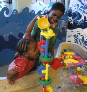 Child plays in Water Room