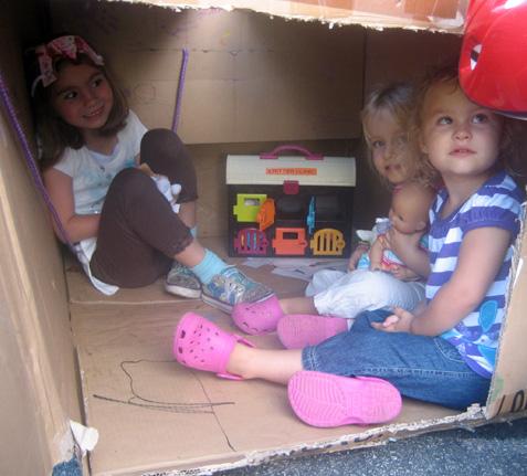 Kids in cardboard box clubhouse