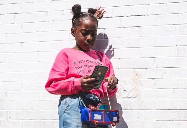 Tween girl with phone
